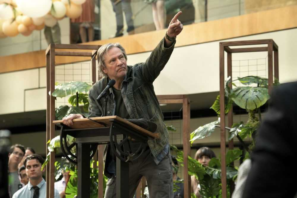 Chris Cooper, standing at a podium, points upward in season 2 of Amazon's Homecoming