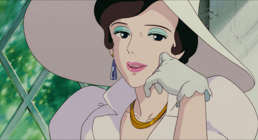 a woman in a white dress and hat