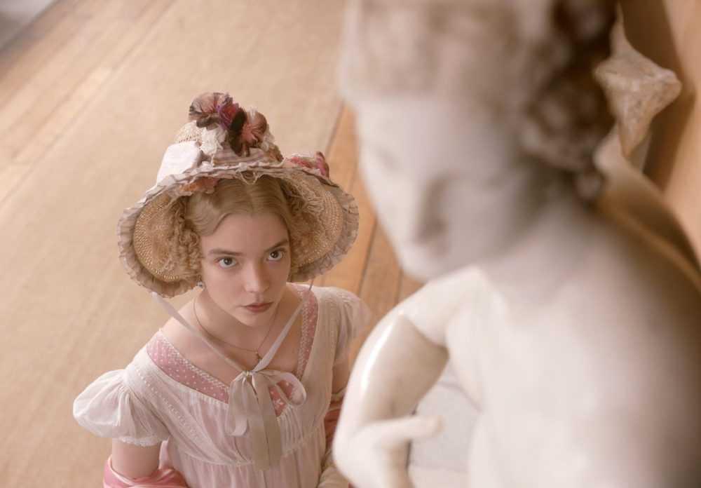 anya taylor-joy as emma, looking up at a statue