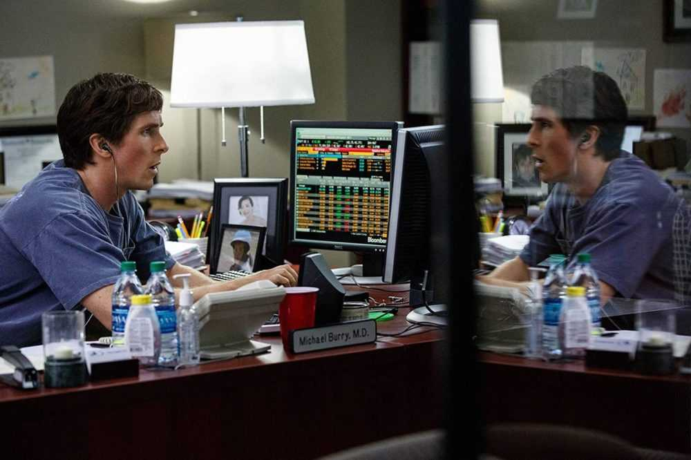 Christian Bale stares at a computer screen in a still from The Big Short