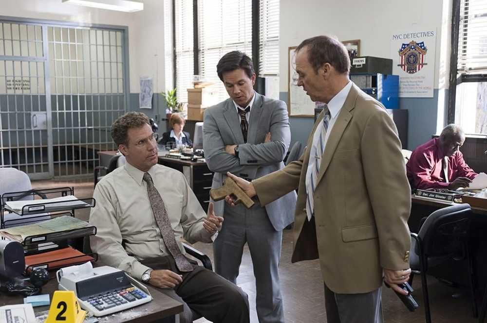 Will Ferrell (seated) Mark Walberg and Michael Keaton in a screenshot from The Other Guys